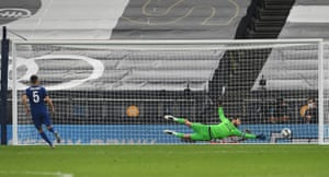 Chelsea's Jorginho scores a penalty during a penalty shootout.