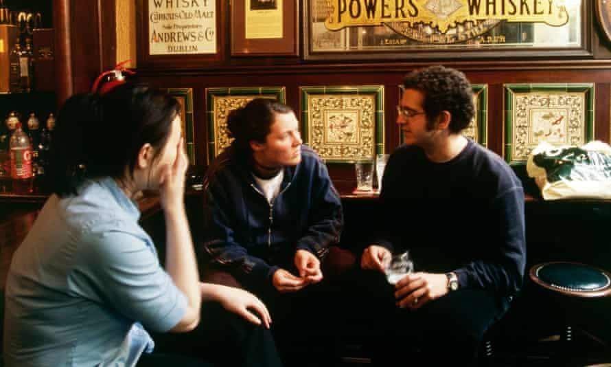Customers enjoying a drink in McDaids pub, Dublin, Ireland.