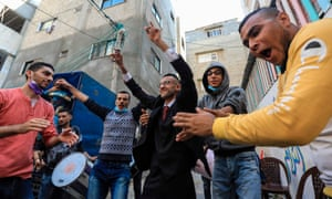 Palestinian groom Mohammed Ahmed Ashour dances with male relatives and friends while waiting for his bride during his wedding ceremony amid the Covid-19 pandemic, in Gaza City.