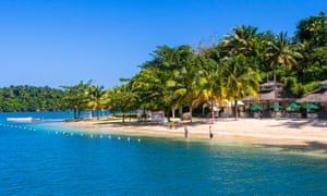 Beach scene in bright sunshine at Port Antonio, Jamaica.