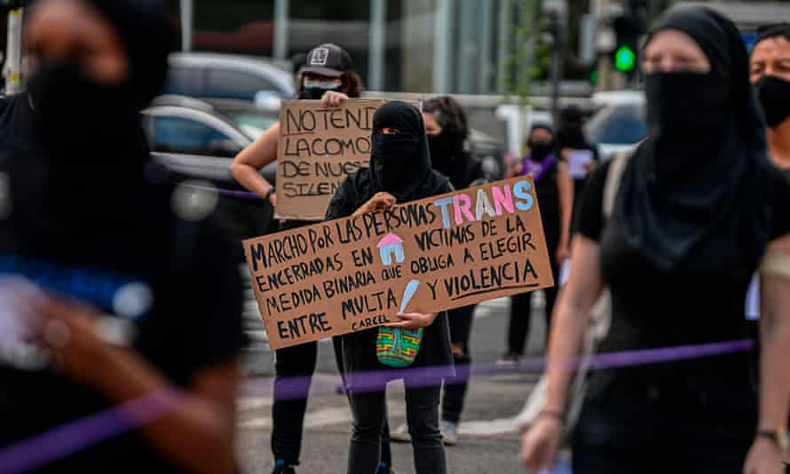 "Women take part in a Panama City protest against the segregation measures. The sign reads ""I march for trans people imprisoned in their homes because of the choice between prison and violence""."