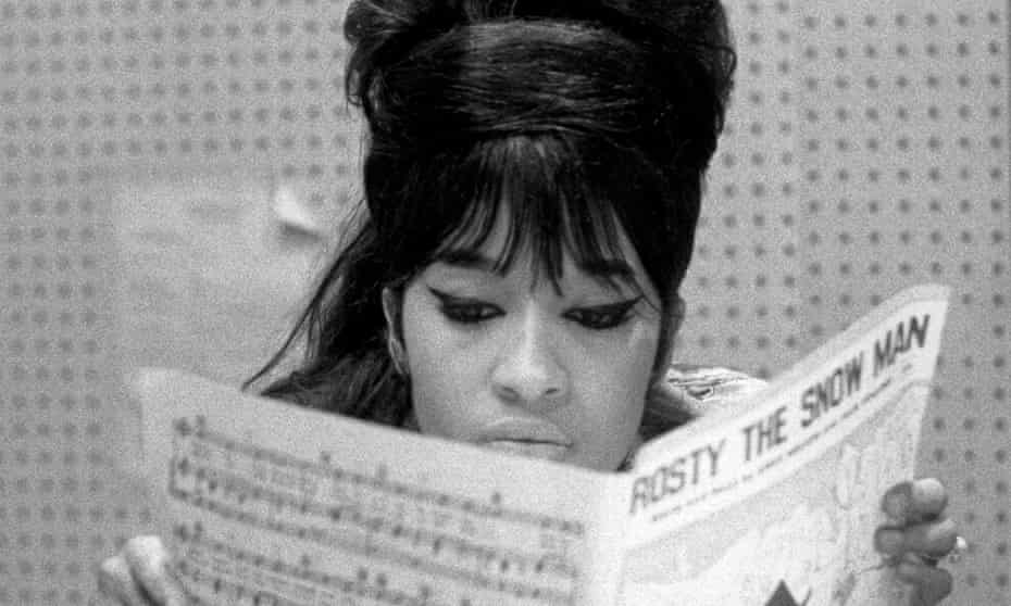 Spector studying the sheet music for Frosty the Snowman, 1963.