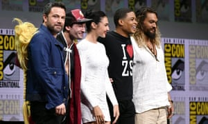 Ben Affleck, Ezra Miller, Gal Gadot, Ray Fisher and Jason Momoa appear at Comic-Con International in San Diego.