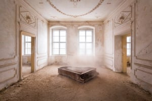 An abandoned house in Poland captured by 'Urban photographer' Roman Robroek. See Masons copy MNABANDONED: This stunning series of pictures reveal the interiors of beautiful but abandoned buildings across Europe. The images show crumbling frescoes inside deserted villas, overgrown palace conservatories and winding castle staircases. 'Urban photographer' Roman Robroek spent five years scouring the continent to find and photograph the grandest examples of forgotten architectural beauty.