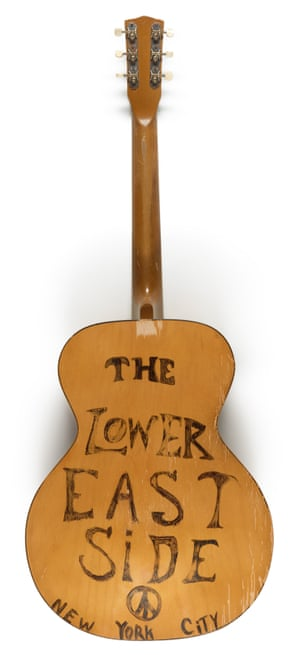 John Lenon: semi-acoustic guitar, inscribed by Lennon, 1975 This guitar is decorated with the name of the Lower East Side, best-known as David Peel's backing band. Their album 1972, The Pope Smokes Dope, was produced by John Lennon and Yoko Ono, whilst the band also occasionally performed as part of the Plastic Ono Band. Estimate: £10,000 - £15,000