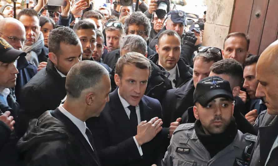 Emmanuel Macron and Israeli security officers in the Church of St Anne, Jerusalem