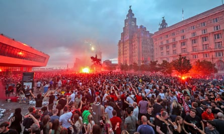Fans ignite flares outside the Liver Building in Liverpool on Friday. But a firework caused serious damage to the building.