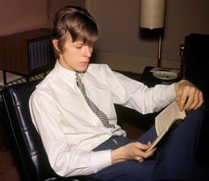 David Bowie reading a book, in 1995.