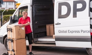 A DPD delivery driver delivering parcels in Southwold, Suffolk.