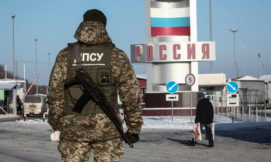 A member of the Ukrainian border guard service at a crossing point on the border between Russia and Ukraine in the Kharkiv region.