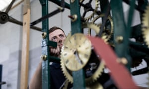 Apprentice clockmaker Tom Ratcliffe working on a mechanical armchair cage clock at Smith of Derby.