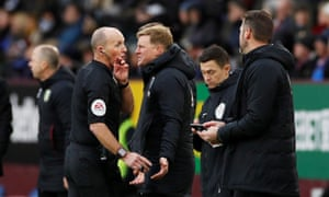 Bournemouth's Eddie Howe and Neil Moss remonstrate with referee Mike Dean after VAR disallowed their goal and awarded Burnley a penalty.