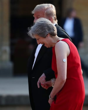 May and Trump holding hands at Blenheim Palace.