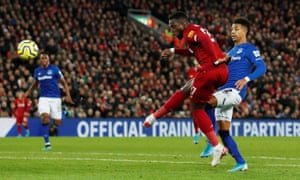 Liverpool's Divock Origi scores their third goal.