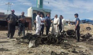 People and Iraq security forces gather at the site of an earlier car bomb attack in Balad Ruz in the eastern province of Diyala, on 8 May.