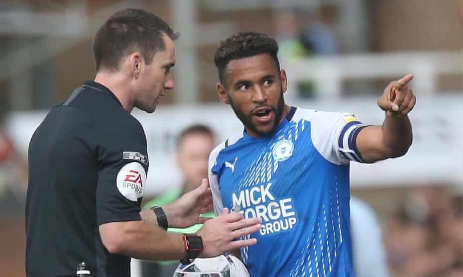 Peterborough's Nathan Thompson talks to referee Jarred Gillett.