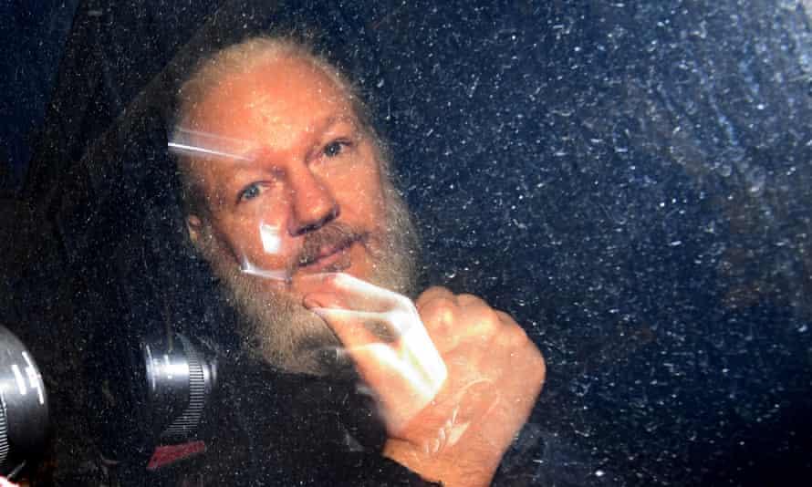 Julian Assange arrives at Westminster magistrates' court in London in April 2019