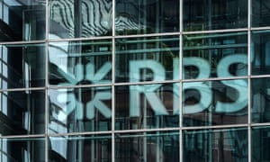 The RBS logo hangs behind glass at the bank's headquarters in London.