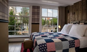 Bedroom overlooking a canal at the Max Brown Canal District hotel in Amsterdam.