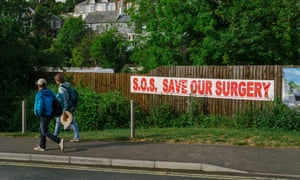 Campaigners in Megavissey, Cornwall, put up banners across the village to raise awareness of the struggle to find a GP in order to prevent the local surgery closing