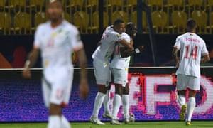 Benin's forward Mickael Pote (second right) celebrates his second goal.
