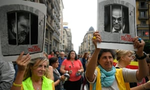 In Barcelona, protesters hold placards of jailed separatists after nine Catalan leaders were sentenced for their role in a failed 2017 independence bid