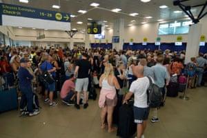 Passengers wait for their flights inside the Ioannis Kapodistrias International Airport in Corfu, Greece today
