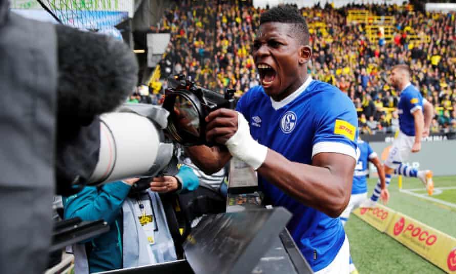 Schalke's Breel Embolo celebrates their third goal scored at Dortmund.