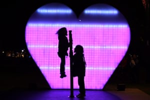 Children at the I Love You installation at First Fleet Park as part of the Vivid Sydney festival of light