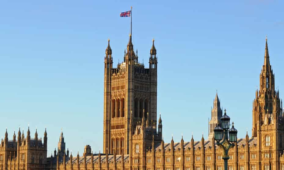 A union flag flies on top of the Victoria Tower, part of the Palace of Westminster in London.