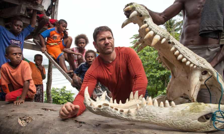 Steve Backshall with the Asmat tribe and a crocodile they killed.