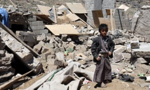A Yemeni boy stands in the rubble of a house destroyed by a Saudi airstrike.