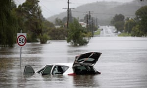 A car stranded in Bulahdelah on Sunday after the Myall River broke its banks.