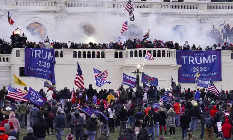 Rioters supporting Donald Trump storm the Capitol in Washington DC on 6 January 2021. Of the more than 160 people arrested by the end of January, almost one in five were current or former members of the military, NPR reported.