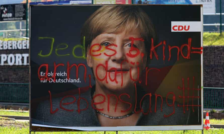 """A defaced CDU campaign poster in Schmiedeberg, Germany. The graffitti reads """"each fifth child = poverty, therefore life imprisonment""""."""