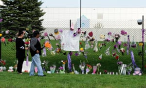 Fans leave flowers outside Prince's home in Paisley Park, Minnesota.