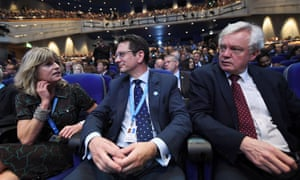 Steve Baker (centre) a week ago today at the Conservative conference, listening to the Boris Johnson speech alongside Rachel Johnson and David Davis.