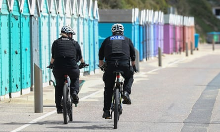 Police officers patrolling Bournemouth beach in Dorset earlier this year.