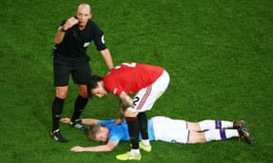 Concern for Kevin De Bruyne of Manchester City after he hits the turf.