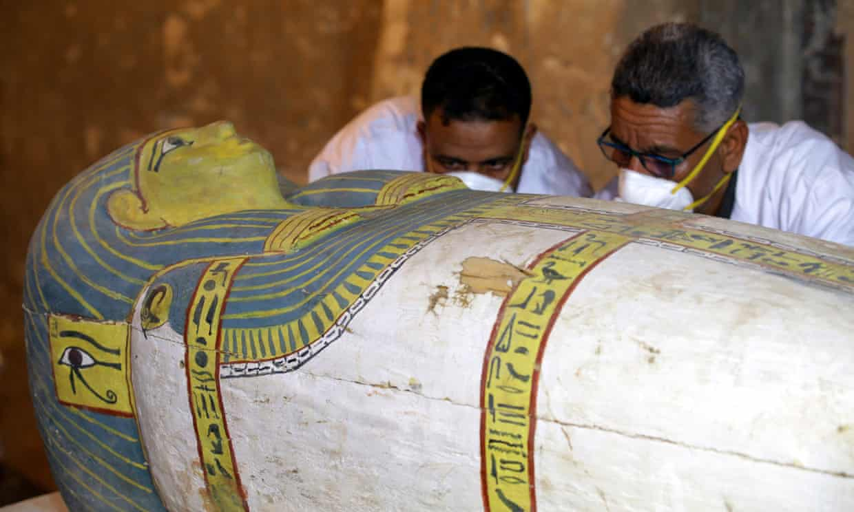 Archaeologists inspect the sarcophagus, which revealed a mummy of a woman called Thuya.