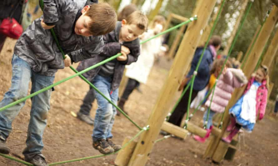 The farm also features a woodland play area. Children are seen playing in it.