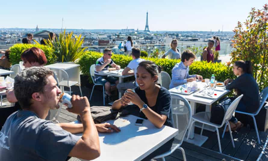 Diners at a Parisian rooftop cafe