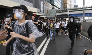 Protestors run near the Legislative Council in Hong Kong as the administration prepared to open debate on a highly controversial extradition law.