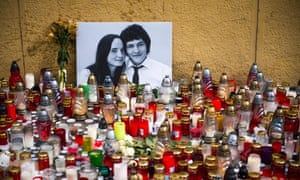 Candles placed in front of a portrait of investigative journalist Ján Kuciak and his girlfriend, Martina Kušnírová