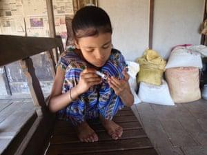 Banchana Khadka trims her nails