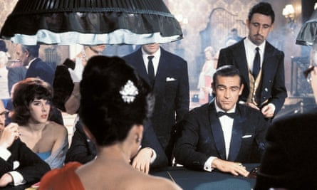 Sean Connery as James Bond at a casino table, with a woman looking at him