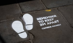 Social distancing markers in Camden Market, north London, which has reopened today as part of a wider easing of lockdown restrictions in England.