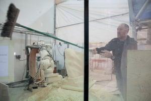 A robot arm sculpts a piece of foam for a film prop