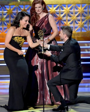 Veep star Julia Louis-Dreyfus accepts the outstanding lead actress in a comedy series award from Debra Messing and Chris Hardwick.