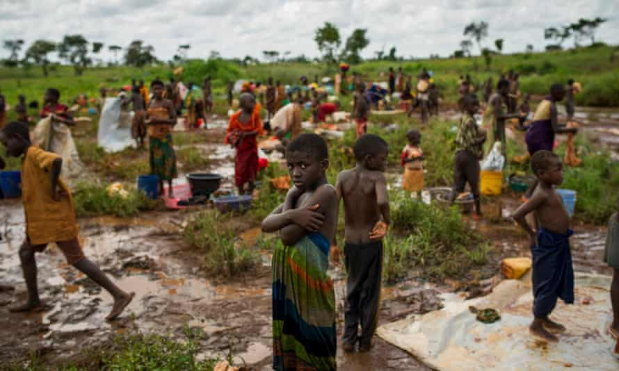 Burundi refugees wash their clothes near a river on the edge of the Nyarugusu refugee camp in Tanzania.